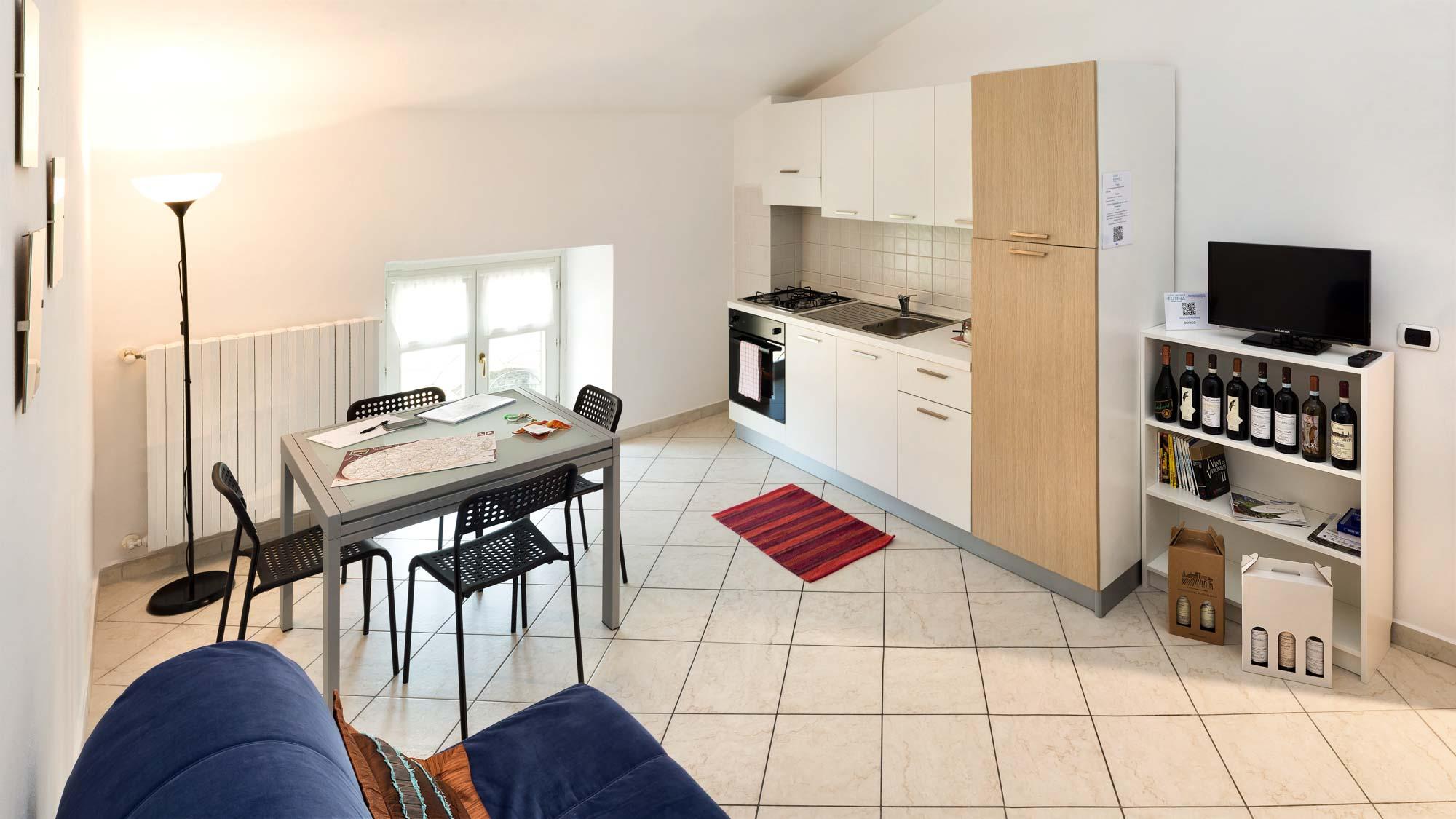 Casa Vacanze Fusina (Dogliani) - Bilocale Borgo: soggiorno ...